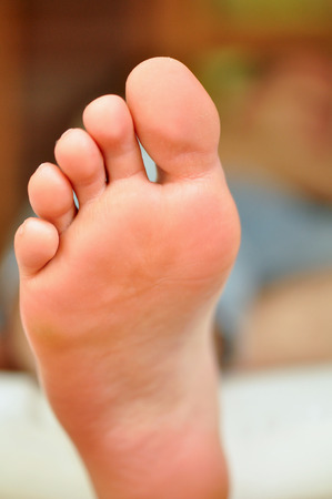 toe tag: sole of the foot of a sleeping man
