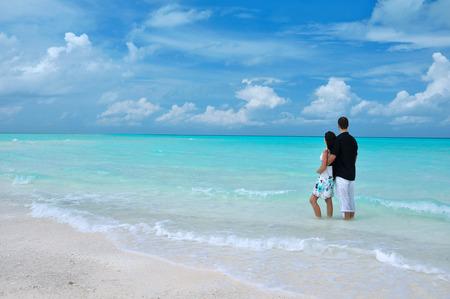 mensch: Couple standing in the sea, Maldives