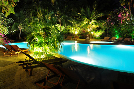 blue swimming pool at night