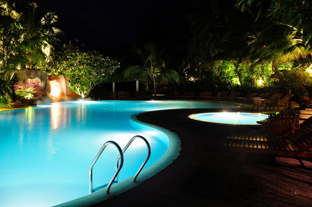 leer: blue swimming pool at night