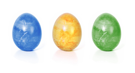 Ostern: three colorful Easter eggs, isolated