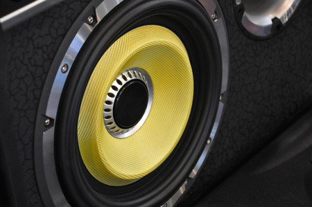 decibel: yellow car speaker, car hifi Stock Photo