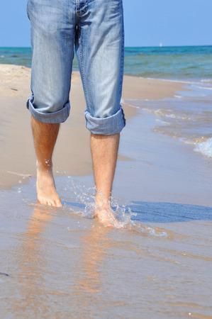 hairy legs: hairy men legs; beach walk