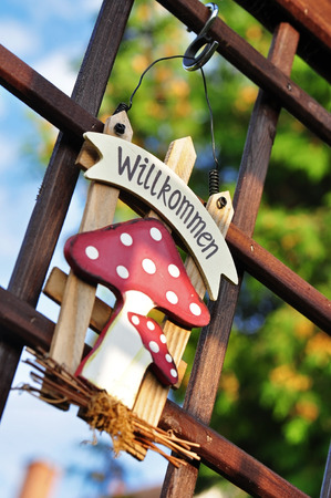 "welcom: Garden decoration with German text  ""Welcome """