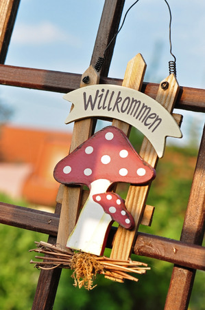 """welcom: Garden decoration with German text  """"Welcome """""""
