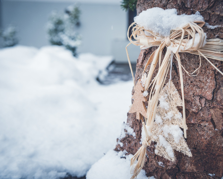 Christmas decoration in the garden - tree trunk