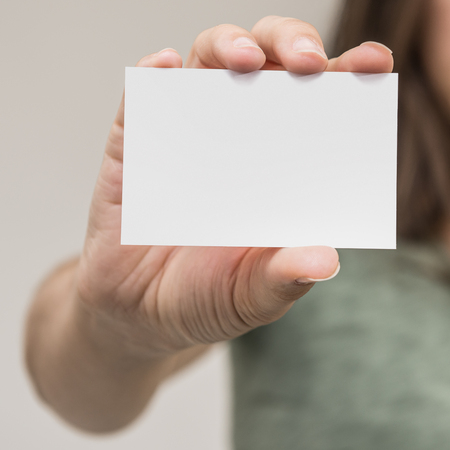 Woman hand is holding a business card 版權商用圖片