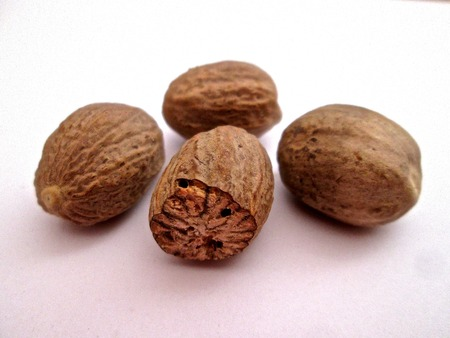 nutmeg: Nutmeg spice on a white paper