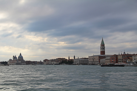 the campanile: Venice landmark, view from sea of Piazza San Marco or st Mark square, Campanile and Ducale or Doge Palace. Italy, Europe.