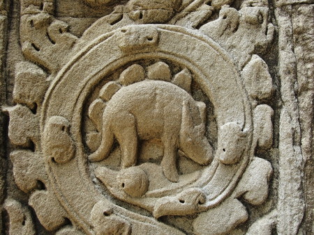 bas: Mysterious bas relief carving depicting a dinosaur at the ancient Ta Prohm temple at Angkor, Siem Reap, Cambodia.