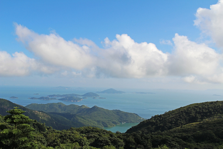 lantau: Beautiful view of the bay in the South China Sea in the summer with the Lantau Island. Hong Kong.