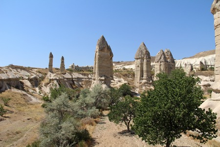 Love valley in Goreme village, Turkey. Rural Cappadocia landscape. Stone houses in Goreme, Cappadocia. Countryside lifestyle. Imagens