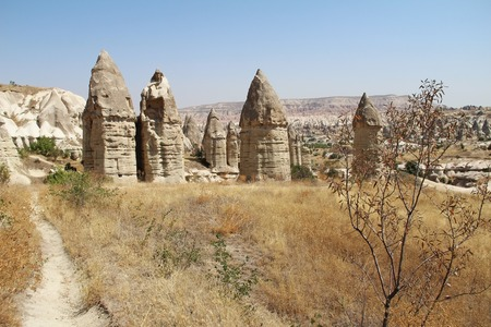 Love valley in Goreme village, Turkey. Rural Cappadocia landscape. Stone houses in Goreme, Cappadocia. Countryside lifestyle. Stock Photo