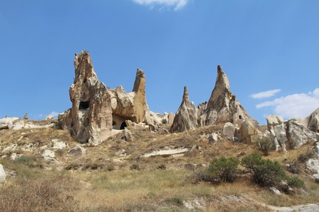 Natural valley with volcanic tuff stone rocks in the evening. Goreme, Cappadocia, Central Anatolia region of Turkey. Popular tourist destination in Turkey for trekking.