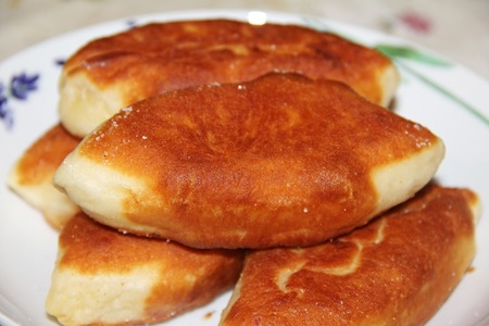 Traditional Russian or Ukrainian homemade pirozhki. Fried pies or patties, closeup. 写真素材