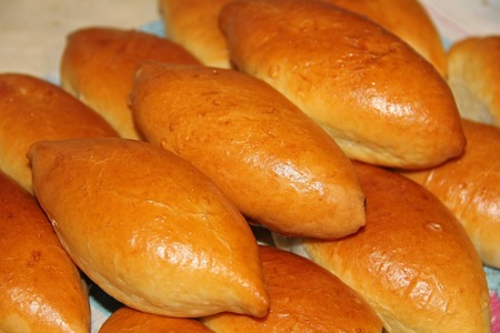Traditional Russian or Ukrainian homemade pirozhki. Fresh baked pies or patties, closeup. 写真素材