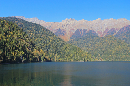 Beautiful mountain Lake Ritsa. Lake Ritsa in the Caucasus Mountains, in the north-western part of Abkhazia, Georgia, surrounded by mixed mountain forests and subalpine meadows. 写真素材