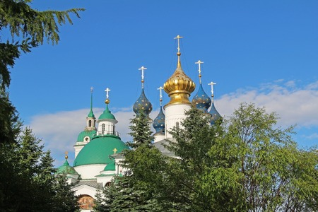 Domes of the Cathedrals of Spaso-Yakovlevsky (St. Jacob Savior) monastery in a summer day. Rostov Velikiy, Russia.