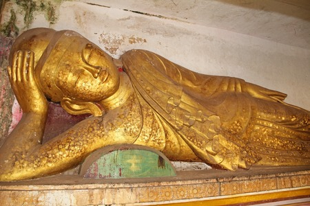 Old golden Buddha statue at Pho Win Taung Caves, Monywa city, Sagaing State, Myanmar, Asia. New interesting tourist destination.