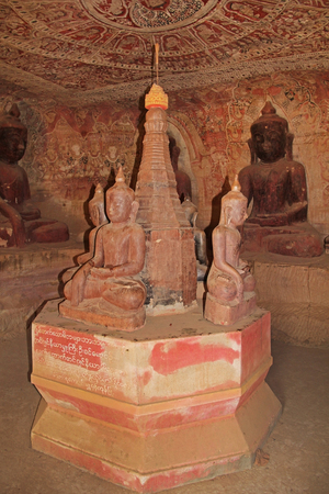 Painting on the walls and old Buddha statues in Pho Win Taung Caves, Monywa city, Sagaing State, Myanmar, Asia. An interesting tourist destination in Asia.