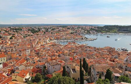 View from the bell tower of the Church of St. Euphemia on the tiled rooftops of the romantic and colorful town of Rovinj, Croatia, located in the north of the Adriatic Sea. Europe. A popular tourist destination.