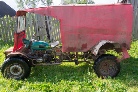 A self-made all-terrain vehicle with a trailer, created on the basis of a motorcycle of the Ural heavy class and from spare parts from motor vehicles.
