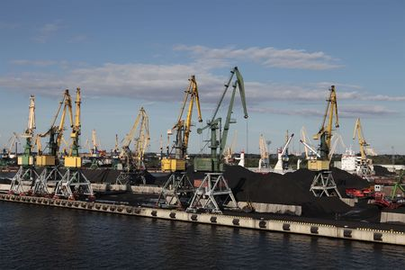 a lot of dock cranes on blue sky photo