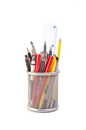 metal holder with different pens and pencils