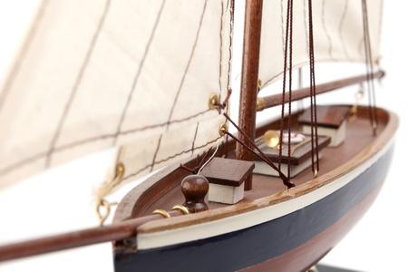 close-up of ship model isolated on white background photo