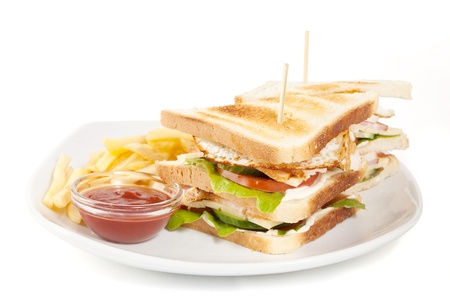 ham sandwich: club sandwich with fries and sauce on white plate isolated on white background
