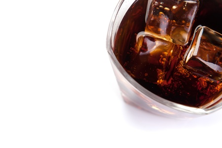 glass of cola with ice on white Stock Photo - 13664623