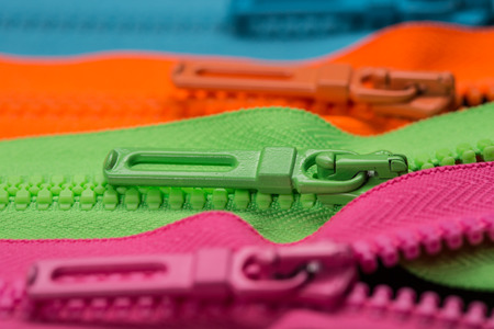 lined colorful zippers with pull tabs Stock Photo