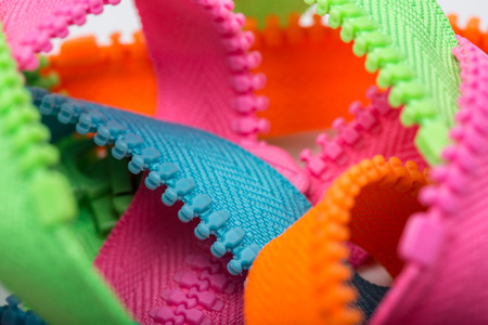 closeup of unsorted colorful zippers