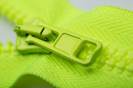closeup of green zipper wit hpull tab