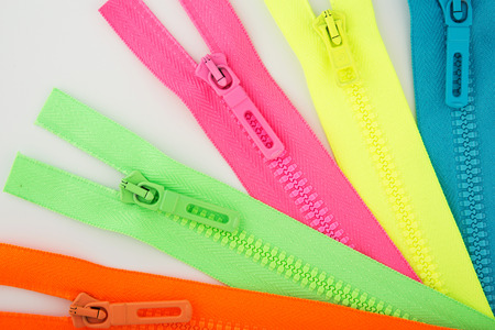 colorful zippers on light