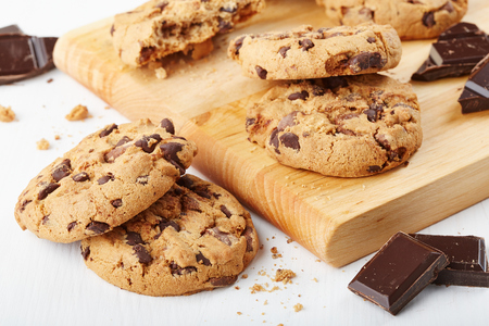 chocolate cookies with chocolate pieces and cutting board