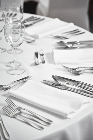 restaurant table setout with silverware and glass