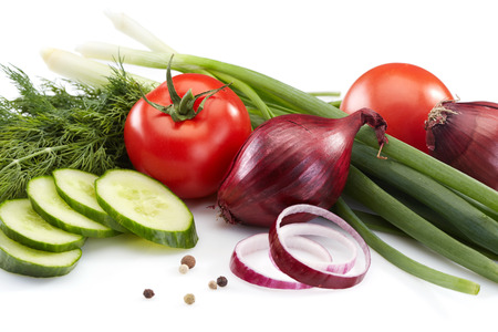 composition of cucumber, onions, chives, tomatoes and dill on white Stock Photo
