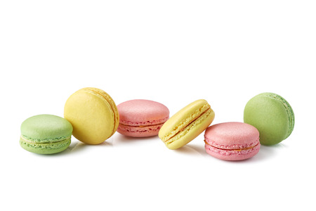fresh red, green and yellow macaroons on white background