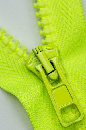 closeup of green zipper wit hpull tab