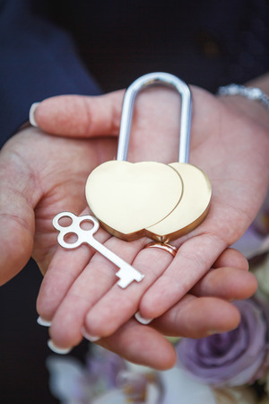 wedding lock in hands Stock Photo