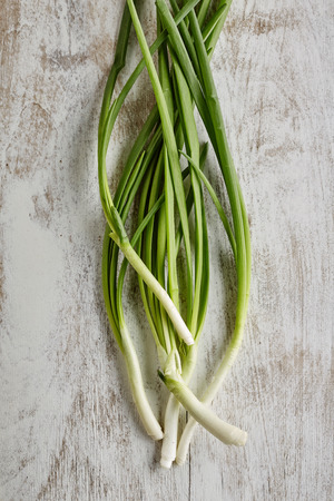 spring onions on rustic wood