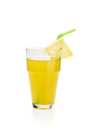 pineapple juice in glass on white