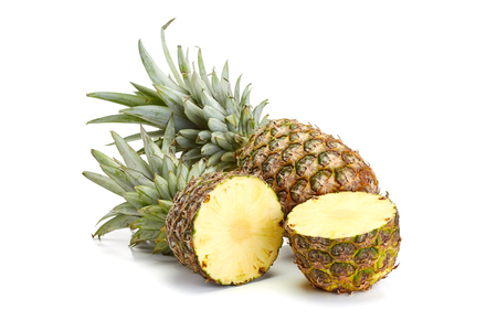 fresh pineapple and one half isolated on white background Stock Photo