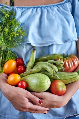 woman hands holding vegetables Foto de archivo