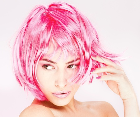 Portrait of a pretty young pink hair woman Stock Photo - 12078926