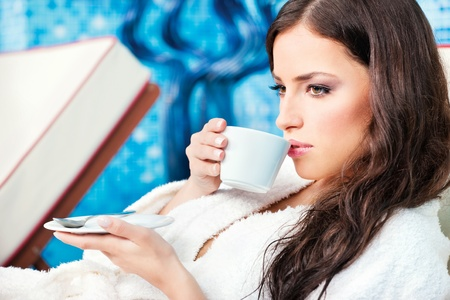 bath robes: Woman enjoy cup of coffee in spa center
