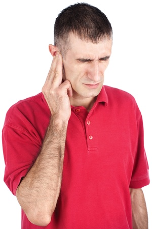 Man have a strong pain in ear, isolate on white background Stock Photo