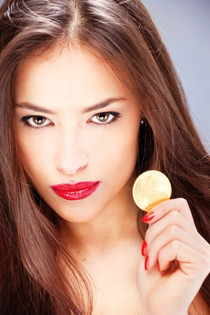Pretty woman holding coin, ducat Stock Photo