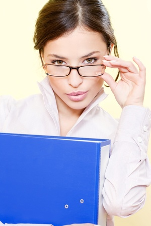 tedium: Portrait of a business woman with file and eyeglasses